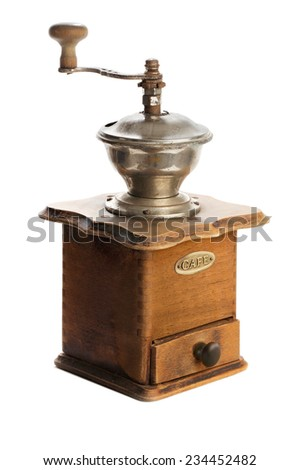 Old coffee grinder isolated on a white background.