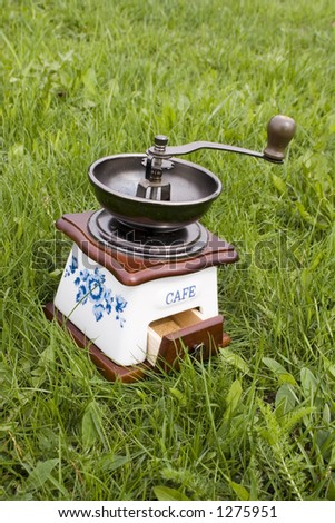 Old coffee grinder on grass #2 - stock photo