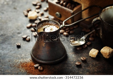 Old coffee pot and mill on dark rustic  background - stock photo