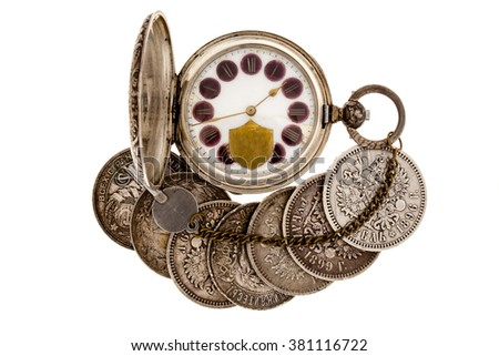 Old coins and pocket watch on a white background. - stock photo