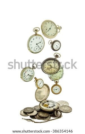 Old coins and soaring on a white background old pocket watch. - stock photo