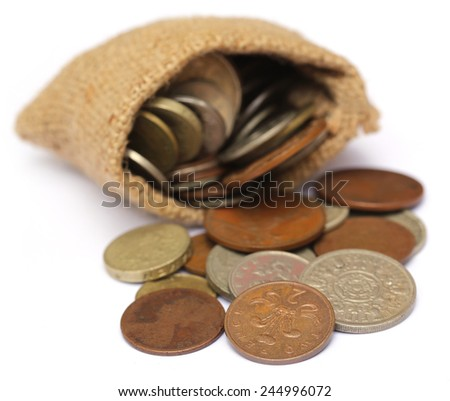 Old coins in sack bag over white background