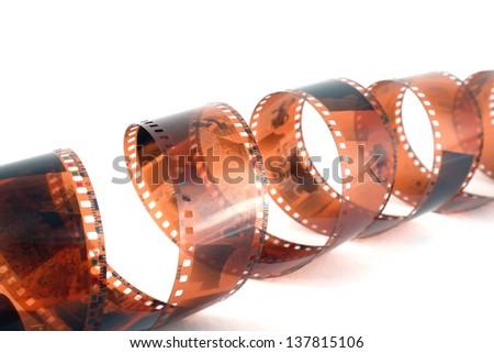 Old color negative film over white - stock photo