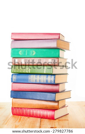 Old colorful books on white background - stock photo