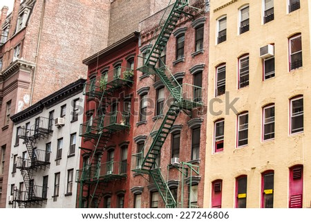 Old colorful buildings with fire escape, New York City, USA - stock photo