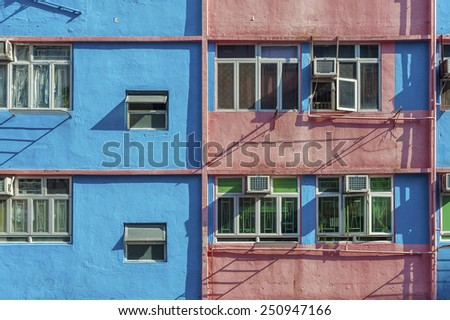 Old colorful residential building in Hong Kong - stock photo