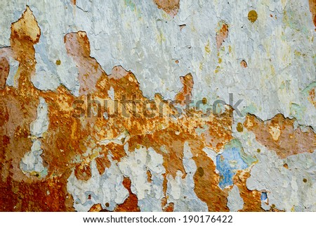 Old, colorful wall texture with peeled mortar and cracks