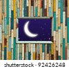 old colorful wood wall with moon and star - stock photo