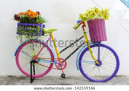 old colourful bike standing on the street - stock photo