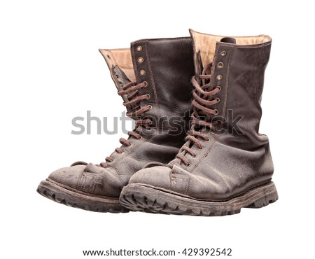 old combat boots isolated on white - stock photo