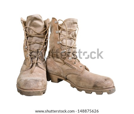 Old combat boots isolated over white - stock photo