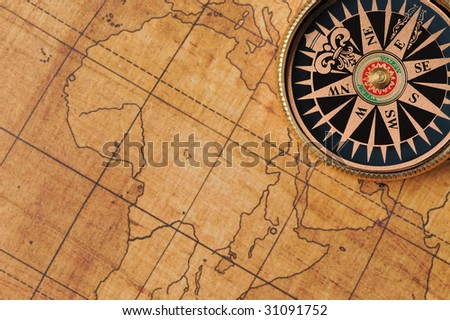 Old compass and map background - stock photo