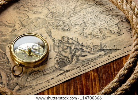 old compass and rope on vintage map 1733 - stock photo
