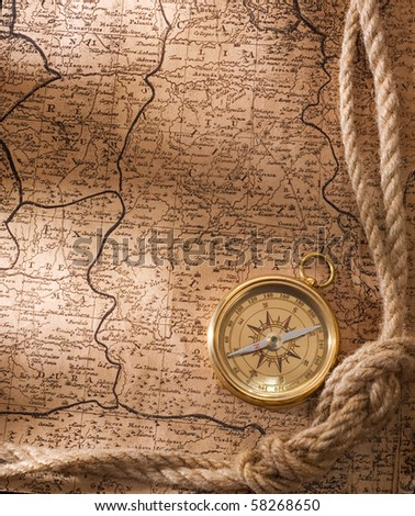 old compass and rope on vintage map  1781 - stock photo