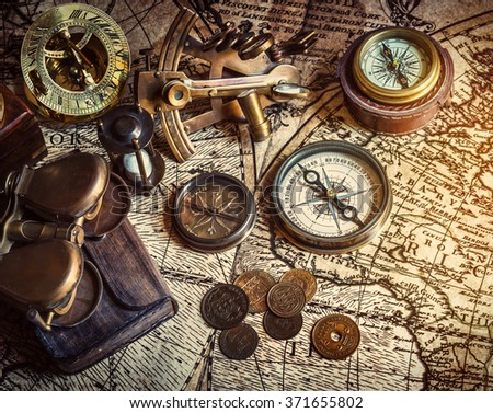 Old compass, astrolabe on vintage map. Retro style. - stock photo