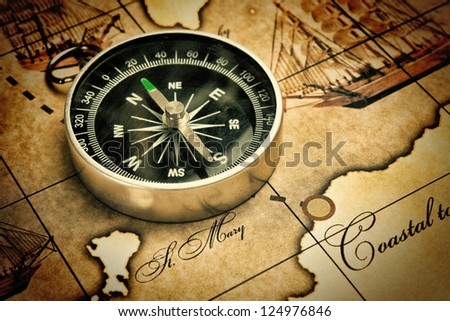 old compass on a map - stock photo