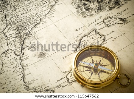 old compass on vintage map 1732 - stock photo