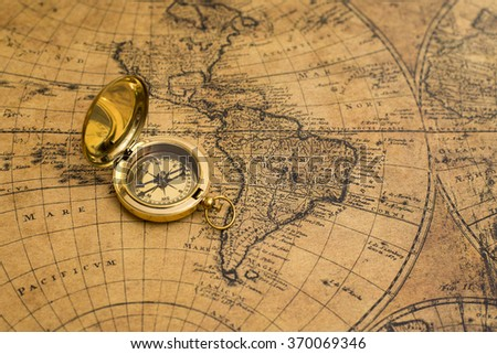 old compass on vintage map - stock photo