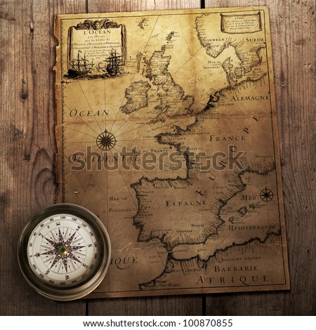 Old compass on vintage map france stock photo 100870855 shutterstock old compass on vintage map france spain england portugal holland gumiabroncs Images
