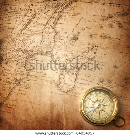 old compass on vintage map ( map Africa mapmaker: Io Matthia Hasio, publisher: Homannianorum H, 1737) - stock photo
