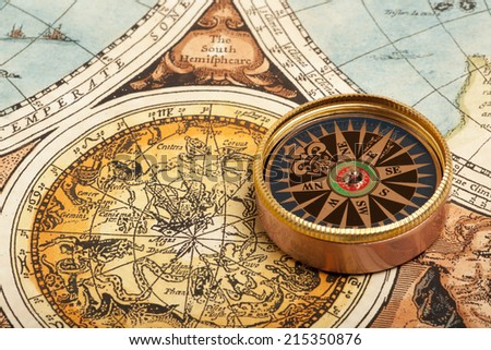 Old compass on vintage retro map - stock photo