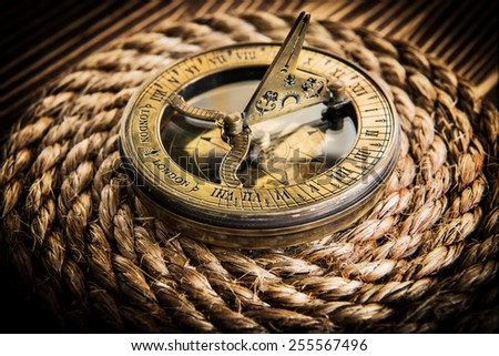 Old compass on wood. Adventure stories background - stock photo
