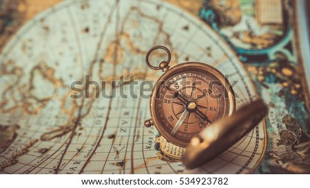 Old compass cover lid on ancient stock photo 534923782 shutterstock old compass with cover lid on ancient world map background a pirate rare item collection gumiabroncs