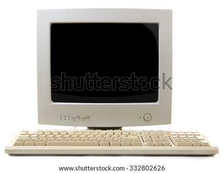 Old computer monitor and keyboard isolated on white - stock photo