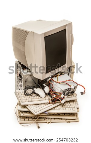 Old computer monitor and keyboards on white - stock photo