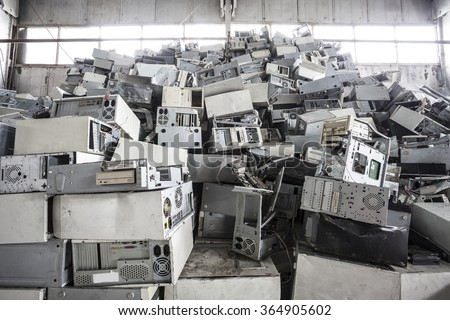 Old computers dump on jubkyard - stock photo