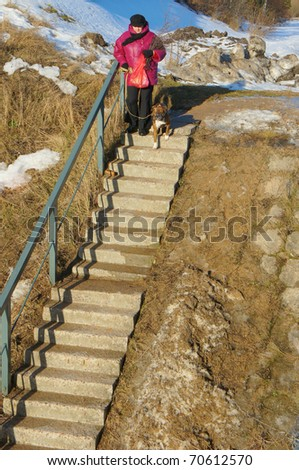 Old concrete ladder with a metal handrail - stock photo