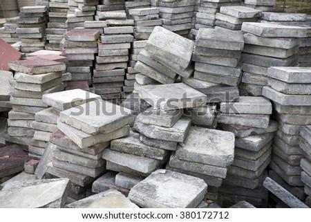 Old concrete paving blocks  - stock photo