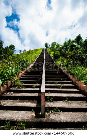 Old Concrete steps of temple with blue sky in Ranong,Thailand