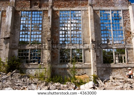 Old Concrete Window with woman - stock photo