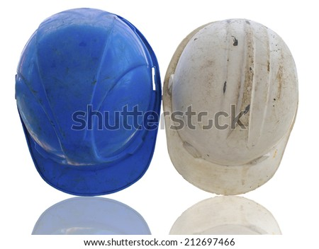Old construction helmets is blue and white color - stock photo