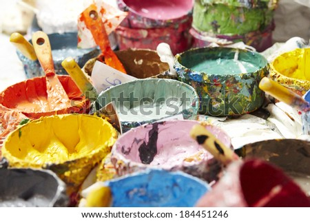 Old containing colorful plastisol silkscreen. - stock photo