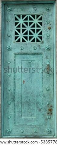 old copper metal door - stock photo
