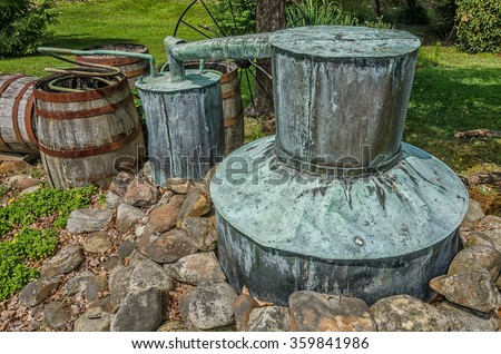 Old copper moonshine still  - stock photo