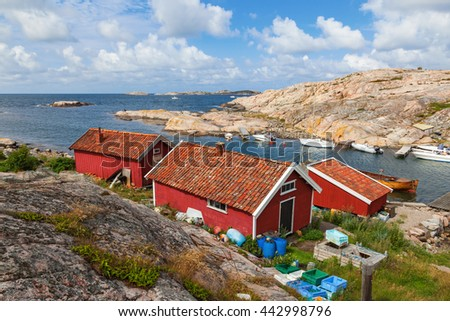 Old cottages at bay on the coast - stock photo