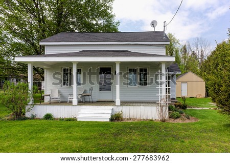 Old country home with open porch - stock photo