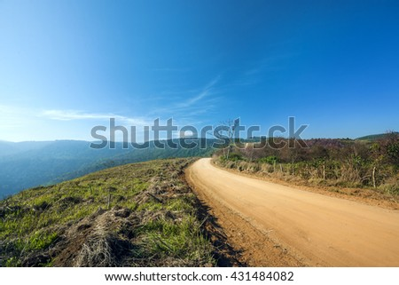 Old country road on hill - stock photo
