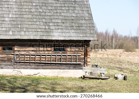 old countryside house with brick chimney and wooden roof - stock photo