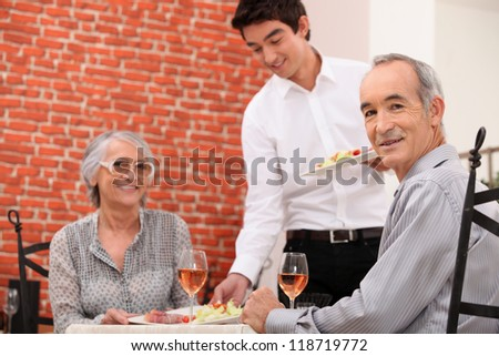 Old couple having meal in restaurant