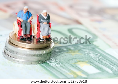 Old couple in a wheelchair with euro money / wheelchair users