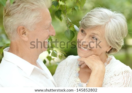 old couple in love walking in the park in spring
