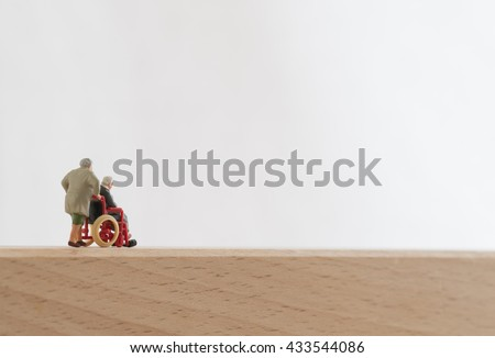 Old couple of the wheelchair - stock photo