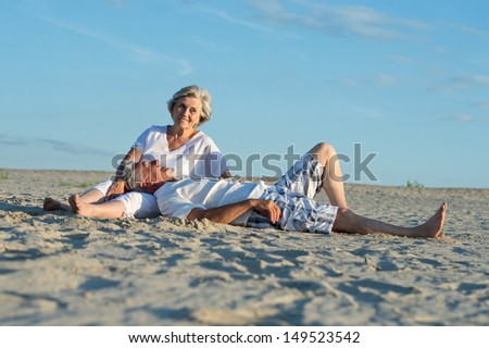 old couple relaxing on a sunny day together - stock photo