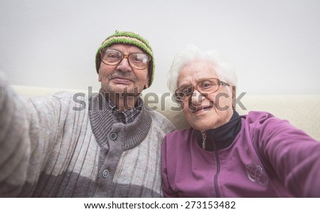 old couple selfie. grandmother and grandfather taking a selfie with camera - stock photo