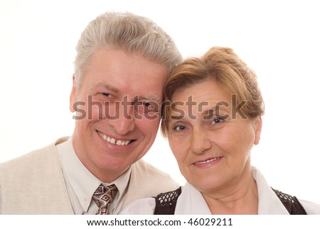 old couple standing together and smiling