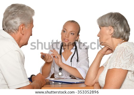 Old couple visitting a female young doctor on white
